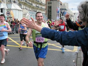 smiling man running for Amaze