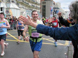 smiling man running for Amaze