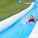 boy on Amaze 100m water slide