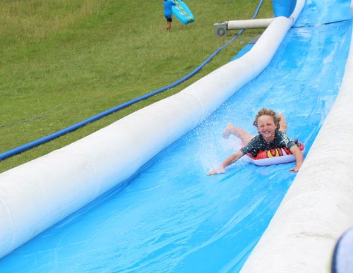 boy on Amaze 100m water slide