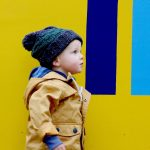 Photo of small child in coat and woolly hat