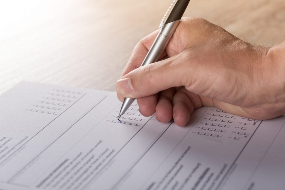 Photo of a form being filled out by hand