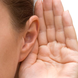 Photo of a hand held up to an ear to indicate listening
