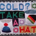 photo of crocheted display saying COLD? TAKE A HAT
