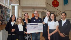 Amaze accept a cheque from fundraising group