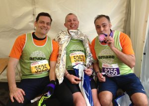 three men celebrate running for amaze