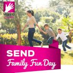 "family playing outdoors and words ""SEND family fun day"""
