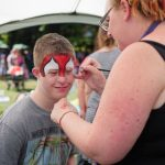 boy at Disability Pride having face painted