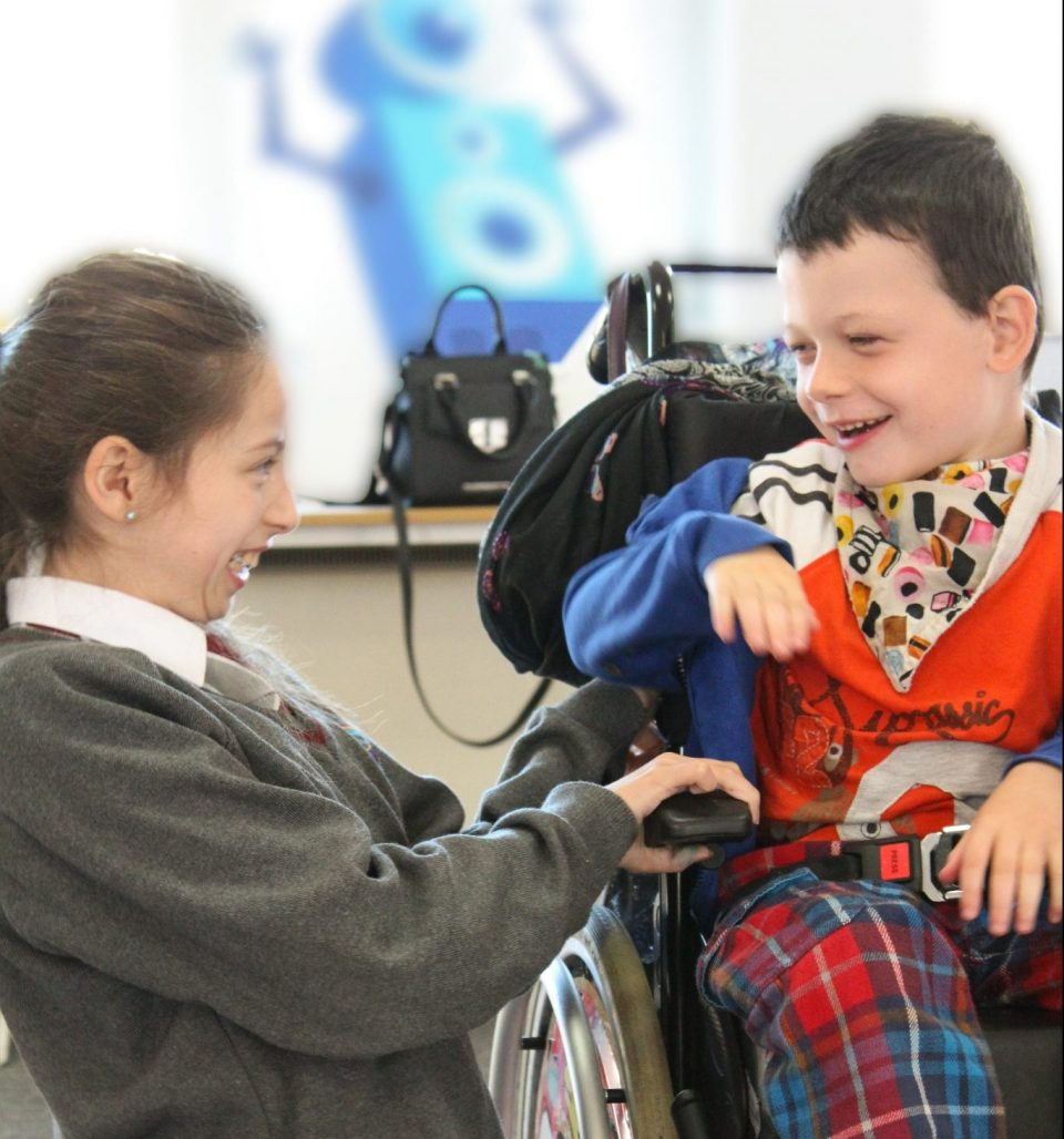 happy boy in wheelchair with girl