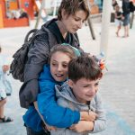 Mum with arms around children