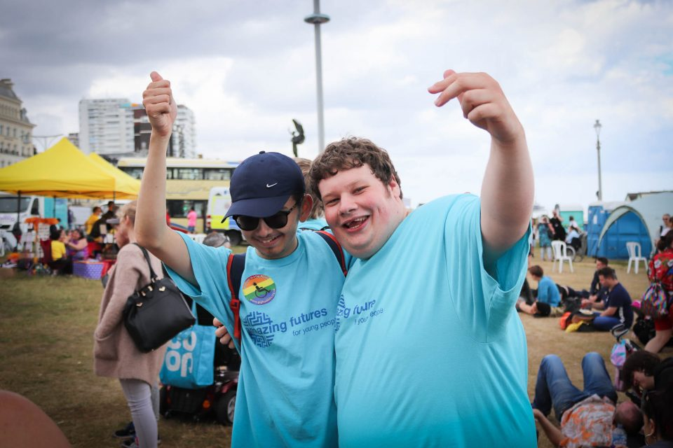 happy young men at disability pride 2019