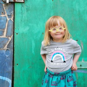 Audrey, young girl with Down syndrome, models Kindness Co-op clothing