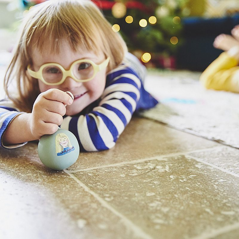 pretty girl with Down syndrome getting ready for Christmas