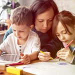 Mum and kids at homeschool learning together