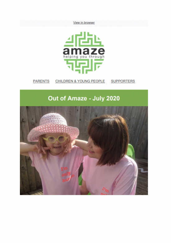 "Front cover of Out of Amaze newsletter, featuring image of smiling young girl in glasses and sunhat, wearing pink t-shirt reading 'I'm only human"", next to woman in matching t-shirt"