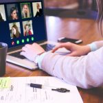 woman using video conferencing software on laptop