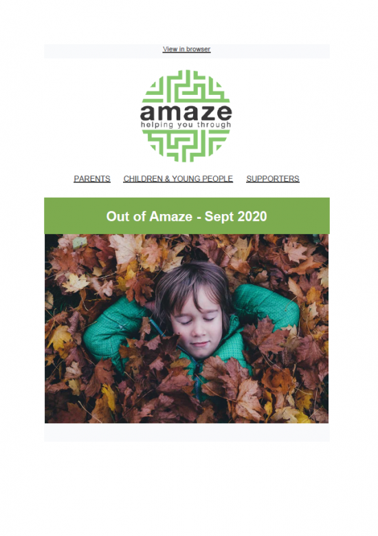 newsletter cover featuring photo of child lying in autumn leaves